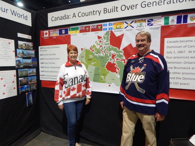 Jane and Joe in front of the popular map of Canada.
