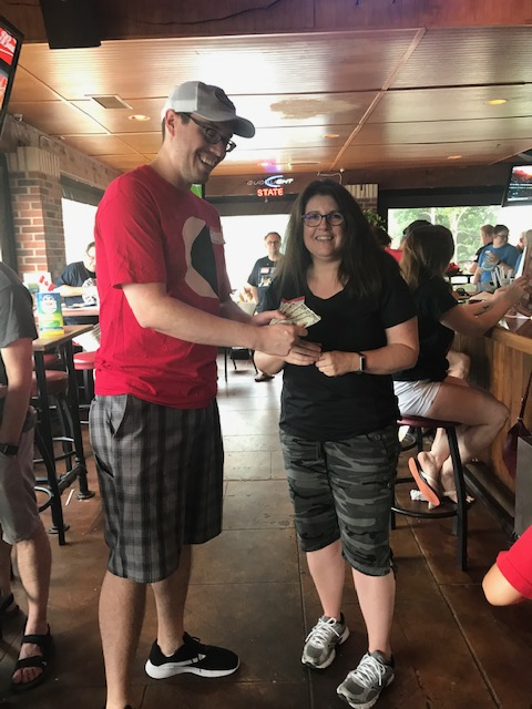Winner of 50/50 draw accepting prize