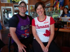 Man wearing Toronto Raptors shirt and woman wearing Canada shirt