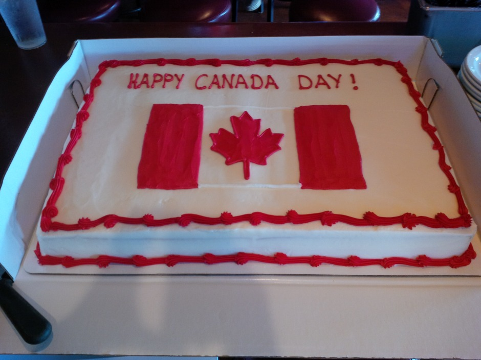 Large cake with a Canada flag drawn on icing